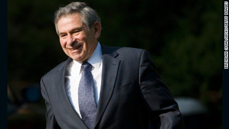 Paul Wolfowitz leaves his home May 16, 2006, in Chevy Chase, Maryland. (Photo by Brendan Smialowski/Getty Images)
