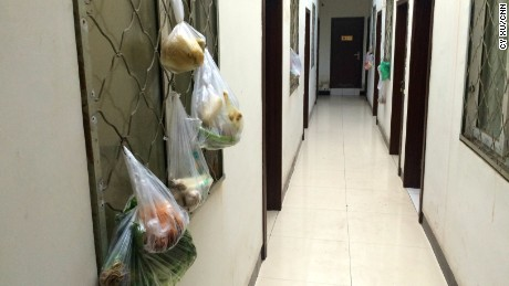 Bags of produce hang on the window frames each room. Many guests use communal kitchen to cut costs.