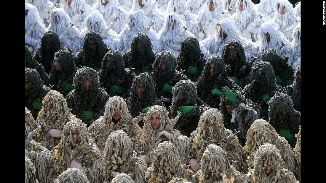 Iranian army troops wearing ghillie camouflage suits participate in the parade just outside Tehran, Iran.