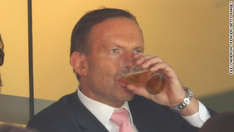 Australian Prime Minister Tony Abbott enjoys a beer during day three of the Fourth Test match between Australia and India at Sydney Cricket Ground on January 8, 2015 in Sydney.