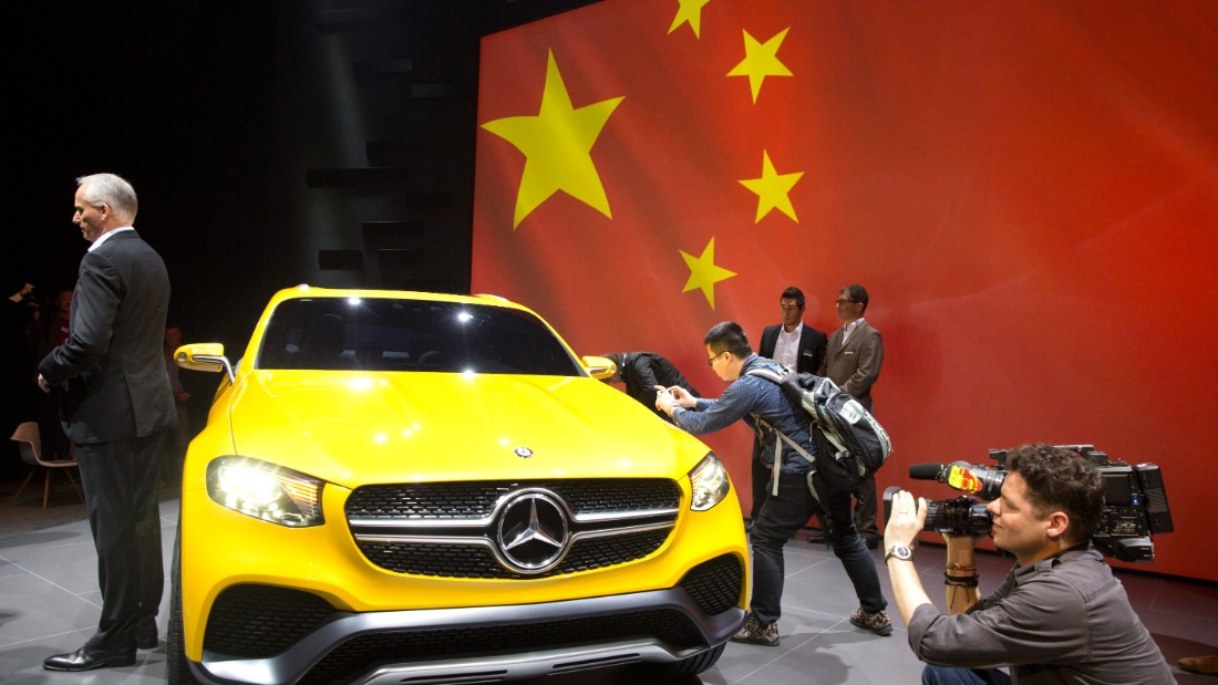 Journalists take photos and video of the Mercedes Benz concept GLC Coupe unveiled ahead of the Shanghai Auto Show.