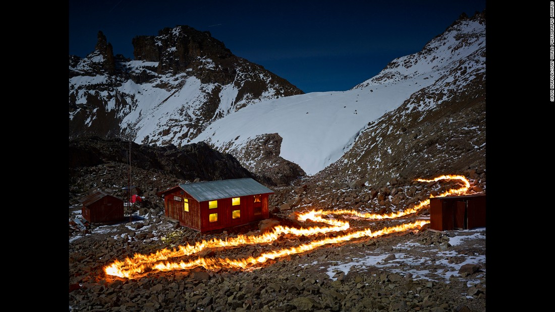 "Nigeria-born landscape photographer Simon Norfolk traced fire across Mount Kenya to show how far the mountain's colossal Lewis Glacier has receded. Norfolk used very long exposures and ""<a href=""http://www.wired.com/2015/04/simon-norfolk-when-i-am-laid-in-earth/"" target=""_blank"">a piece of rolled up gasoline-soaked carpet attached to a rake</a>"" to mark where the edge of the glacier -- which has already shrunk by 90% -- once stood."