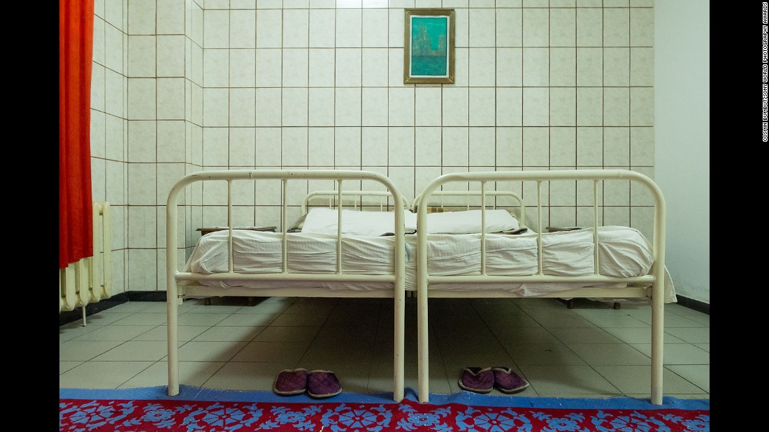 "Romanian photographer Cosmin Bumbut took first prize in the architecture category for his series ""The Intimate Room."" Bumbut spent 4 years visiting penitentiaries across Romania to photograph the cramped rooms built for inmates' conjugal visits from partners on the outside."