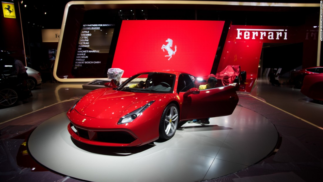 A worker cleans a Ferrari ahead of the 16th Shanghai International Automobile Industry Exhibition in Shanghai.