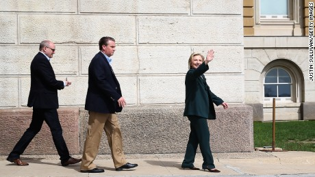 Democratic presidential hopeful and former Secretary of State Hillary Clinton, right, waves as she leaves the Iowa State Capital following a meeting with members of the Iowa State legislature on April 15, 2015 in Des Moines, Iowa.