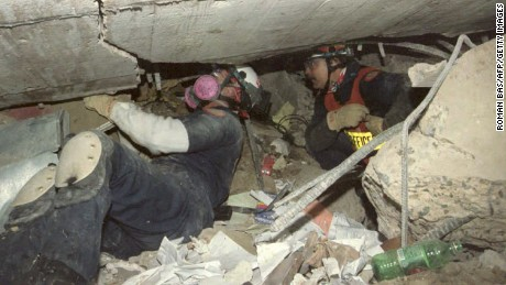 Rescue workers dig through rubble in the 1995 Oklahoma City bombing.