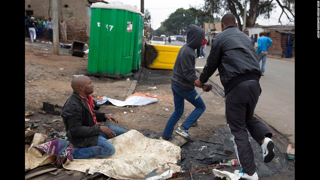 The attackers eventually moved on and left Sithole alone. Oatway and fellow journalist Beauregard Tromp rushed Sithole to a hospital, where he later died.
