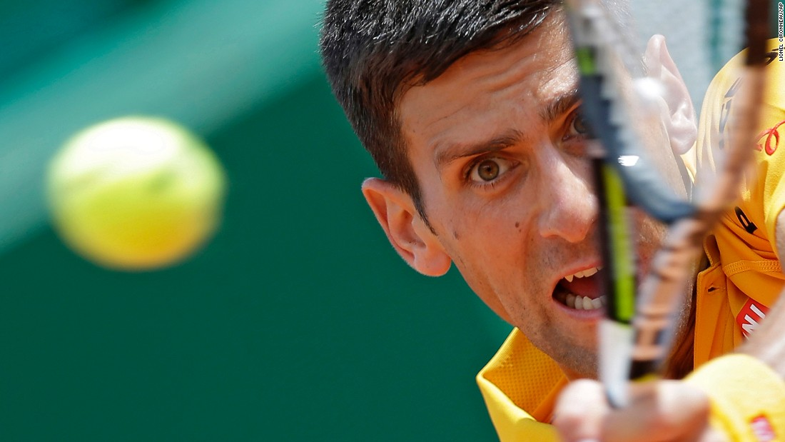 "Novak Djokovic plays a shot Friday, April 17, during a quarterfinal match at the Monte Carlo Masters in Monte Carlo, Monaco. Djokovic would go on to win the tournament and <a href=""http://www.cnn.com/2015/04/19/tennis/tennis-djokovic-wins-monaco/"" target=""_blank"">become the first man</a> to win the opening three Masters tournaments of the season. Djokovic also won the Australian Open earlier this year."