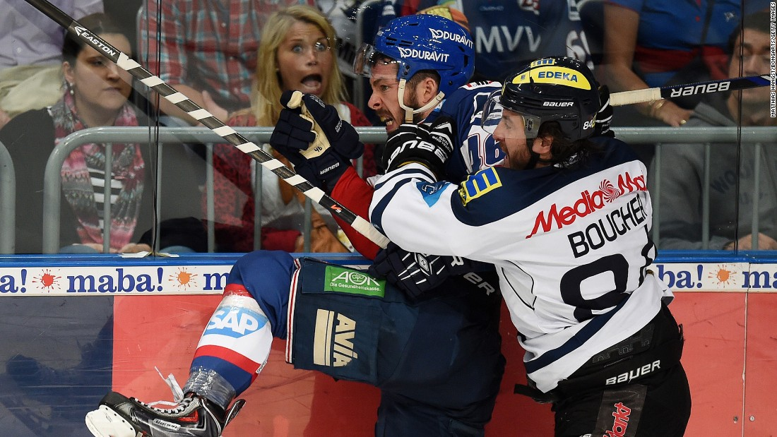 Ingolstadt's Jean-Francois Boucher checks Mannheim's Jonathan Rheault on Tuesday, April 14, during Game 3 of the German league playoff finals. Ingolstadt won the away game 6-1.