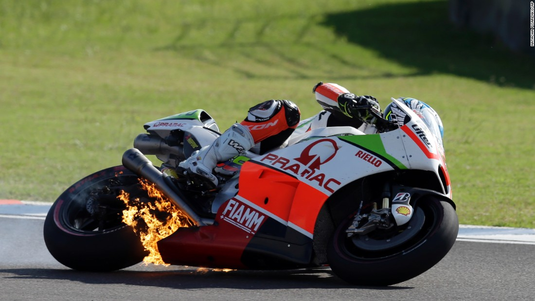 The engine of Yonny Hernandez's motorcycle bursts into flames during the MotoGP race in Argentina on Sunday, April 19. The mechanical issue forced Hernandez out of the race.