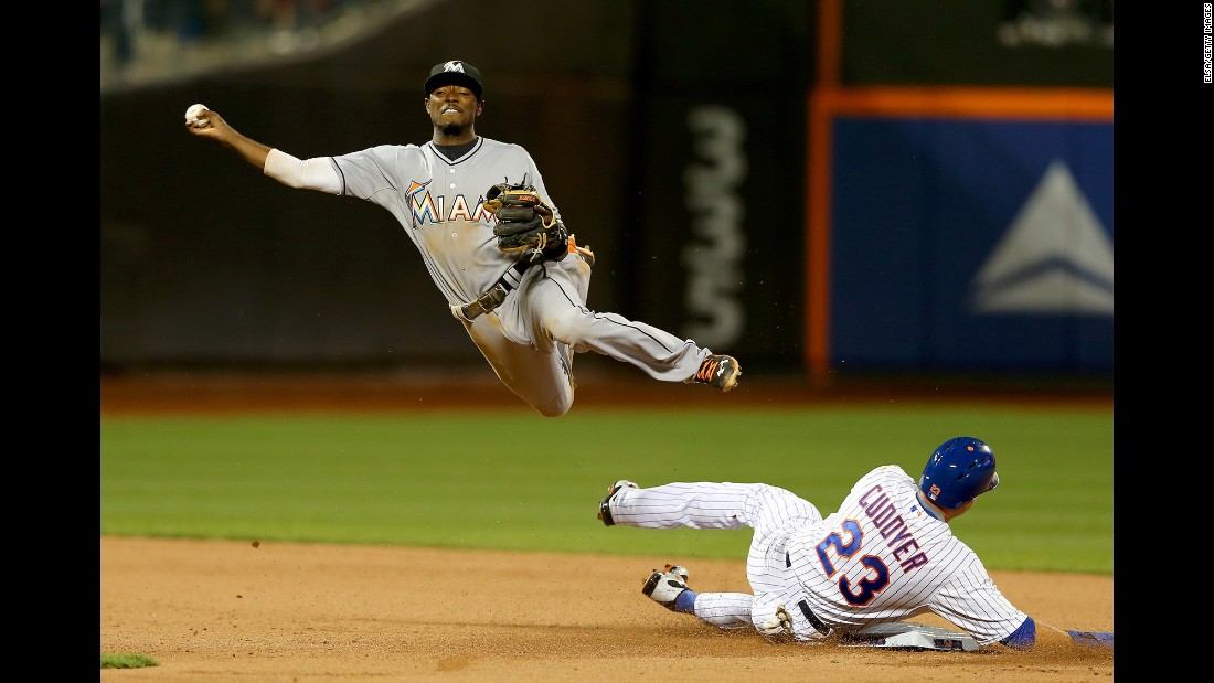 Miami's Dee Gordon tries to turn a double play while playing the New York Mets on Saturday, April 18.
