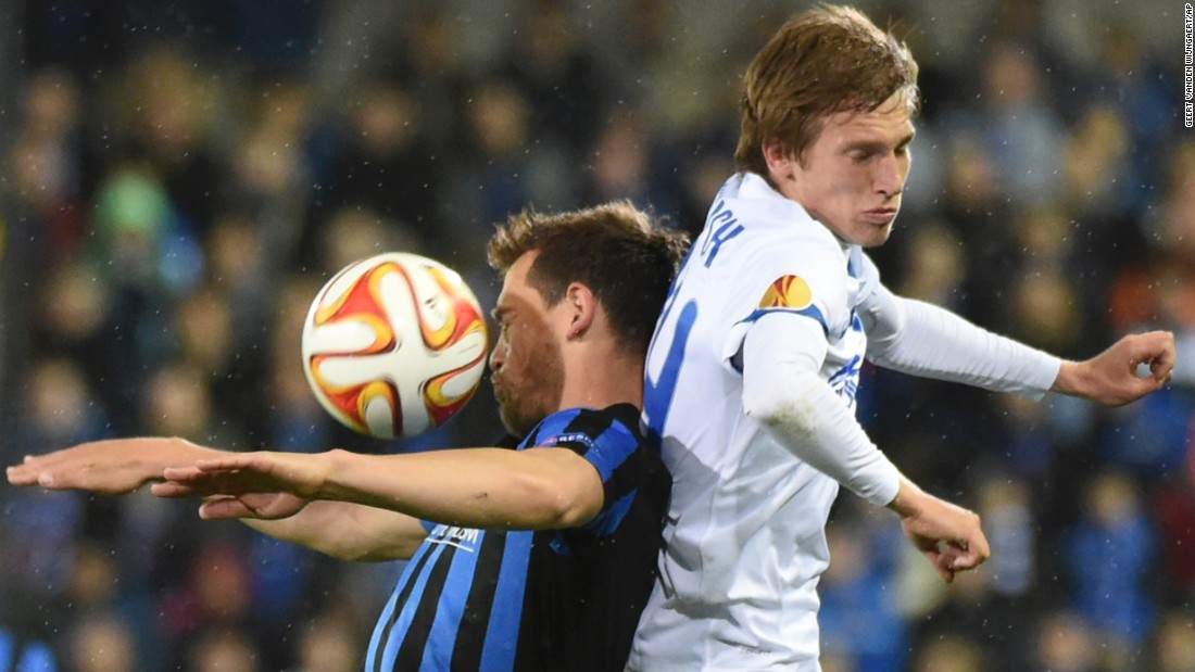Club Brugge's Tom de Sutter, left, and Dnipro's Valeriy Luchkevych, right, collide during a Europa League quarterfinal match on Thursday, April 16. The match in Bruges, Belgium, ended scoreless. The second leg will be played in Dnipropetrovsk, Ukraine.