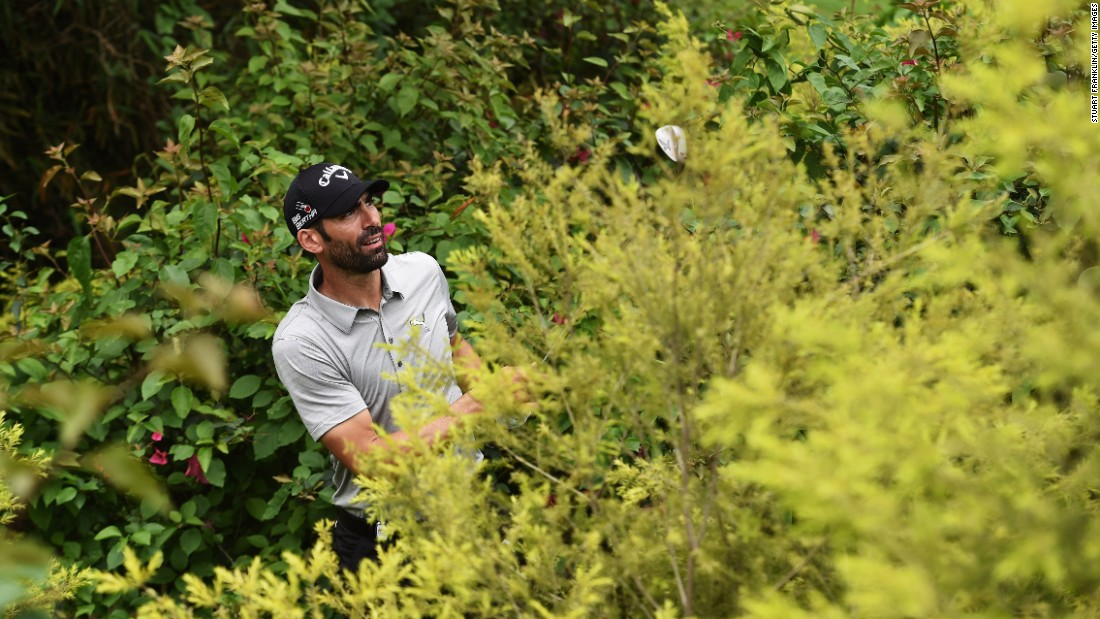 Alvaro Quiros plays a shot from the bushes Sunday, April 19, during the final round of the Shenzhen International in Shenzhen, China. He still managed to shoot a 63 and finish the tournament tied for 15th.
