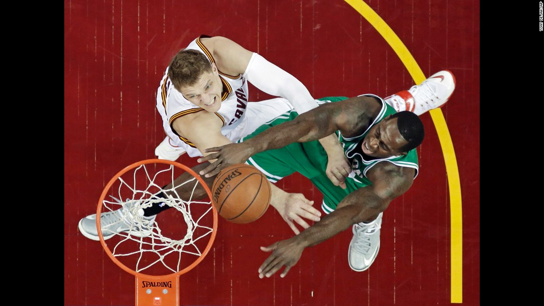 Boston's Brandon Bass, right, is defended by Cleveland's Timofey Mozgov on Sunday, April 19, during Game 1 of their Eastern Conference playoff series. Cleveland won the home game 113-100.