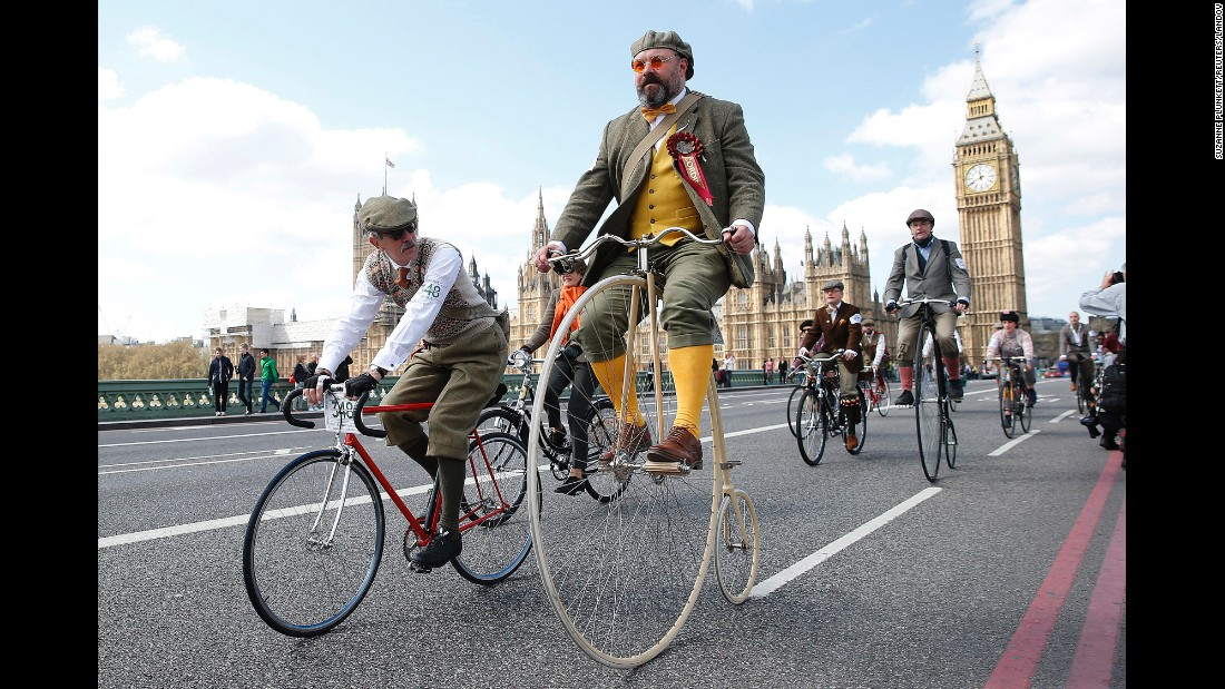 Participants in the Tweed Run ride their bicycles over London's Westminster Bridge on Saturday, April 18. The Tweed Run is an annual event in which people wear vintage clothing and ride their bicycles though city centers worldwide.