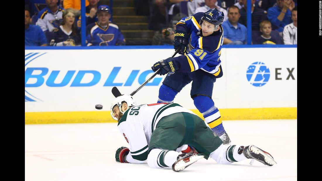 St. Louis forward Vladimir Tarasenko shoots the puck past Minnesota's Marco Scandella during Game 1 of their Western Conference playoff series on Thursday, April 16. Minnesota took the opening game 4-2.