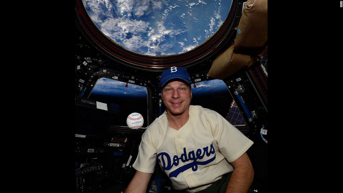 "NASA astronaut Terry Virts honors legendary baseball player Jackie Robinson as he wears a Robinson jersey <a href=""https://instagram.com/p/1gGn5JoaDR/?taken-by=nasa"" target=""_blank"">aboard the International Space Station</a> on Wednesday, April 15."