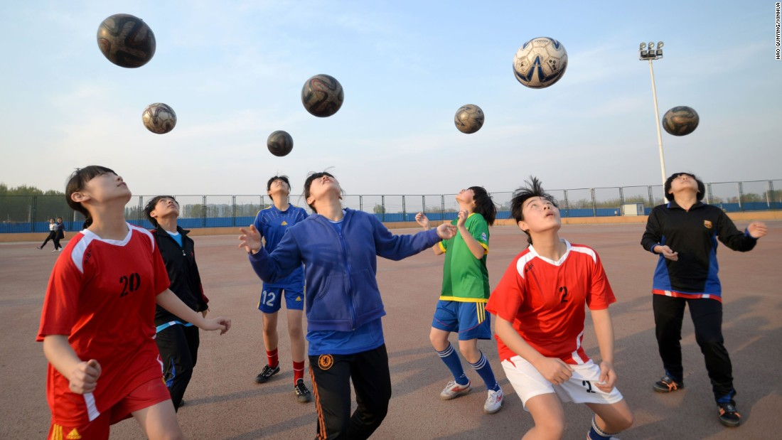 Girls practice soccer skills at a middle school in Handan, China, on Tuesday, April 14.