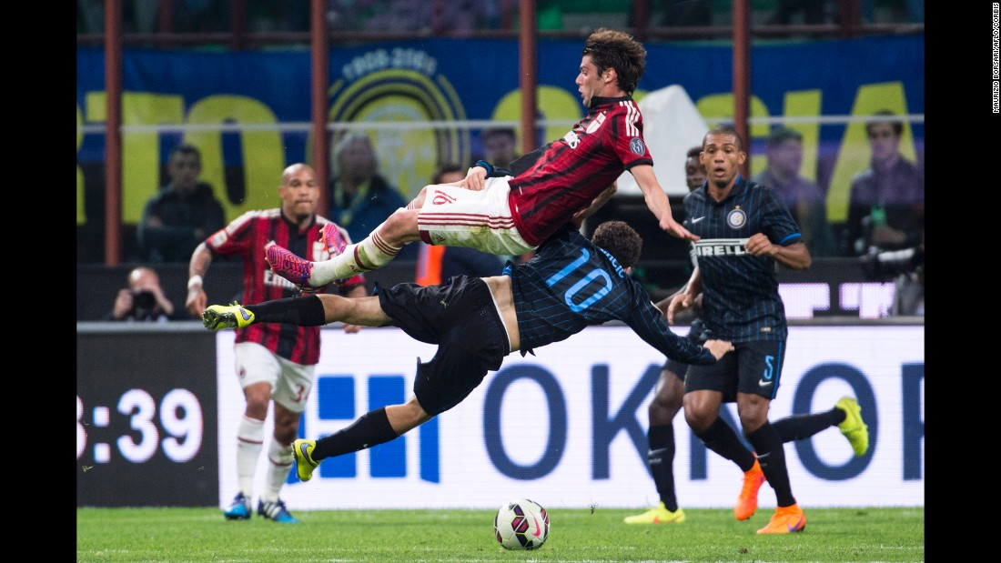 Inter Milan's Mateo Kovacic (No. 10) collides with AC Milan's Andrea Poli during an Italian league match on Sunday, April 19. The match ended 0-0.