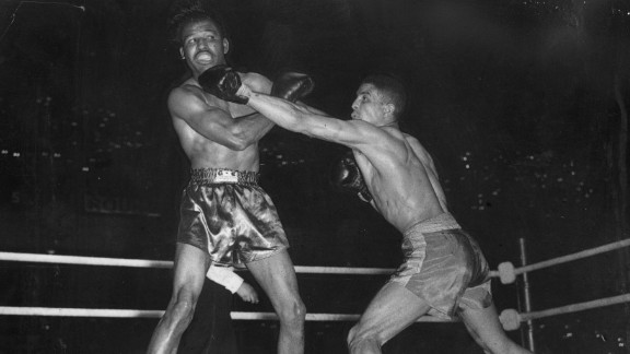 "Mayweather would contest the point, but for many ""Sugar"" Ray Robinson was the best boxer to ever set a foot into the ring. His glittering career was not without its hiccups, however.  Journeying to London with a record of 128-1-2, few reckoned Randy Turpin stood a chance against the American. But blessed with confidence and indefatigable spirit the Brit let fly his jab and kept the dancing feet of Robinson in check, claiming the middleweight crown after 15 rounds."
