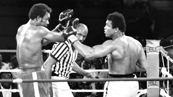 "People thought Ali was past it. People were wrong.  The fight dubbed ""The Rumble in the Jungle"" was pushed back seven weeks after Foreman suffered a cut to the brow during training, but entering the ring he was still the favorite among critics, if not the crowd.  In the baking heat of Zaire, Ali discovered the ring's canvas was too soft and lacked any spring. He reasoned it would be too energy-sapping to go in with his normal style, and so resorted to a tactic he later dubbed ""rope-a-dope."" Ali soaked up Foreman's attacks, offering little counter-punching until he knew the champion was suitably sapped. In the eighth round, after a particularly bruising exchange, Ali pounced, KO-ing an exhausted Foreman and claiming the WBC and WBA titles."