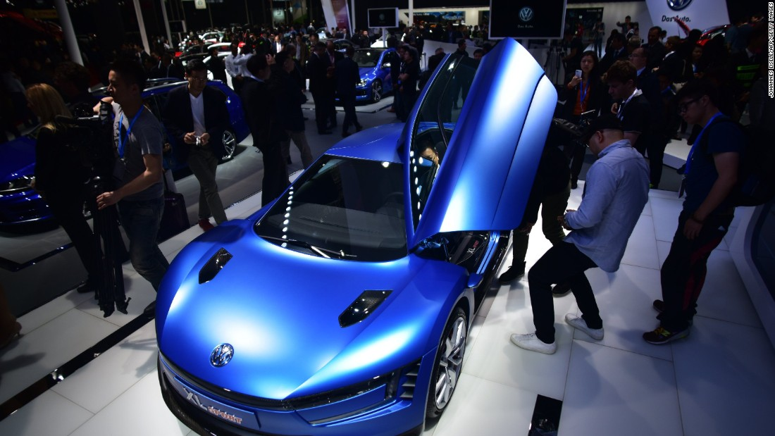 An electric blue VW XL sport concept car grabs attention in Shanghai. First debuted at the Paris Motor Show, the car can accelerate from 0 to 62 mph in 5.7 seconds.
