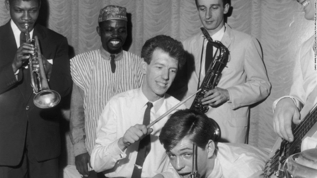 British rhythm and blues singer and keyboard player Georgie Fame (foreground, second from right) and his band The Blue Flames at the Flamingo Club, Soho, London, May 1964. Left to right: Eddie Fountain, Speedy Sacquaye, Red Reece, Mike Eve.