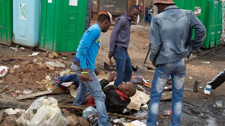 Shocking photos capture fatal xenophobic attack