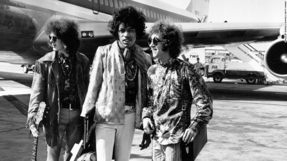 Popular rock trio the Jimi Hendrix Experience at London Airport with their hand luggage. They are, from left to right; Noel Redding (1945 - 2003), bass player, Jimi Hendrix, singer, guitarist and songwriter, and Mitch Mitchell, drummer. Hendrix played his first gig to the press in 1966 at Soho's Bag O' Nails club.