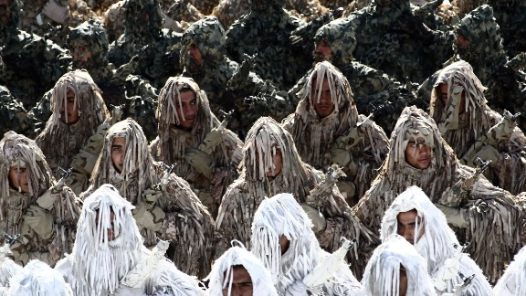 Iranian soldiers wearing ghillie suits, a type of camouflage designed to resemble heavy foliage, march during the annual military parade marking the anniversary of Iran