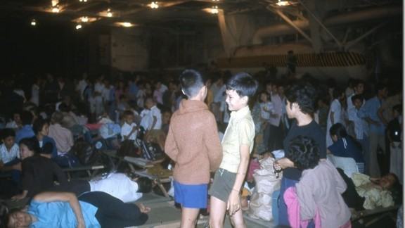 Saigon evacuees pass the time below deck on the Navy carrier USS Hancock in April 1975.