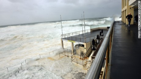 Heavy seas are whipped up by strong winds at Bondi Beach in Sydney on April 21, 2015. Three people died as Sydney and surrounding areas were lashed by wild weather with trees felled, power cuts hitting thousands of homes and sand drifts sweeping inland off the iconic Bondi beach.
