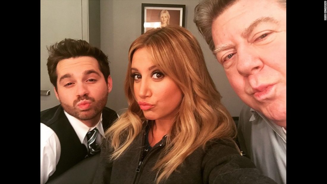 """I got George Wendt to do duck face,"" <a href=""https://instagram.com/p/1jUpjTwaEG/?taken-by=ashleytisdale"" target=""_blank"">actress Ashley Tisdale said</a> on Thursday, April 16. ""And also @ryan_pinkston #missionaccomplished."""