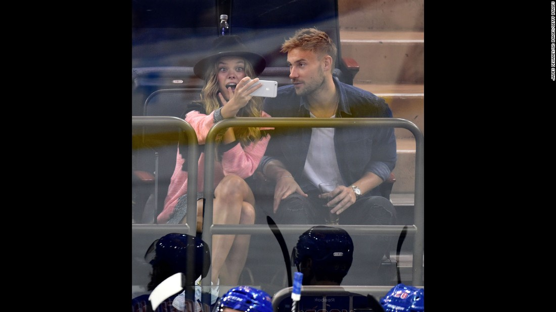Model Nina Agdal takes a selfie while attending a New York Rangers hockey game on Saturday, April 18.
