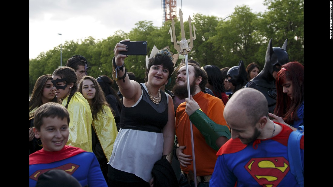 Fans dressed as superheroes from DC Comics take a selfie Saturday, April 18, in San Martin de Valdeiglesias, Spain.