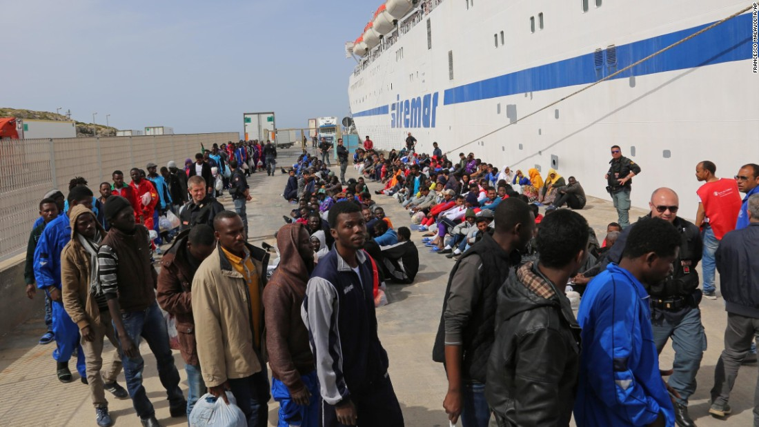 Migrants wait to board a cruise ship as they leave the Italian island of Lampedusa on Friday, April 17.