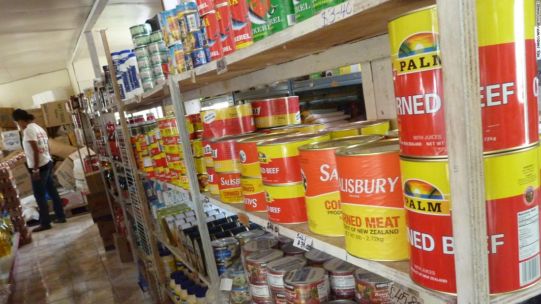 The obesity epidemic began with locals turning their backs on traditional diets of fresh fish and vegetables and replacing them with highly processed and energy-dense food such as white rice, flour, canned foods, processed meats and soft drinks imported from other countries. Pictured, a supermarket in Tonga.