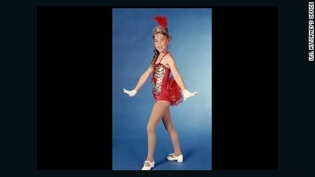 A young Krystle Campbell appears dressed in a tap dancing costume.