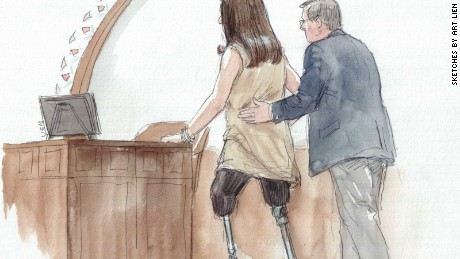 Celeste Corcoran, who lost both her legs in the Boston Marathon bombing, approaches the witness stand to testify in the sentencing phase of Dzhokhar Tsarnaev's trial.
