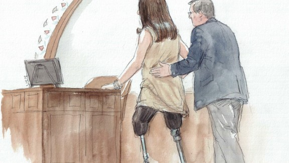 Celeste Corcoran, who lost both her legs in the Boston Marathon bombing, approaches the witness stand to testify in the sentencing phase of Dzhokhar Tsarnaev