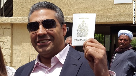 Mohamed Fahmy shows his Canadian passport, which the ambassador gave him on Wednesday in Cairo.