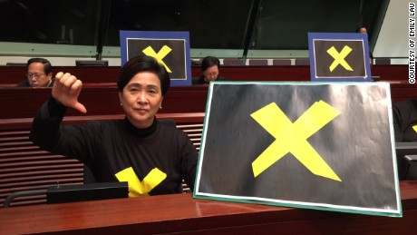 Hong Kong Democratic Party chairwoman Emily Lau signals her intent to to veto.
