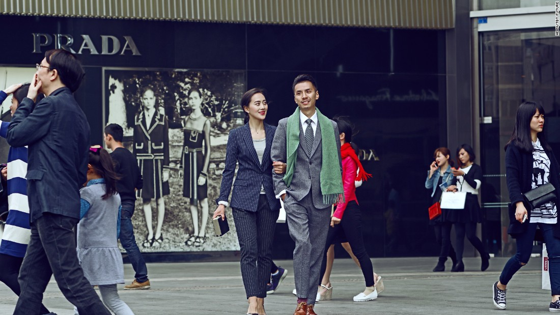 Without wedding gowns and suits, they instead attempted to capture traditional and modern aspects of life in China. In this photo, they are seen wandering on the Chengdu International Financial Square in slick suits.