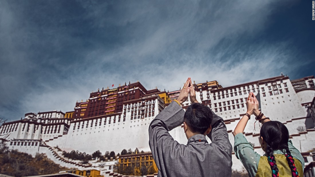 As a result, they went to their homeland to shoot their pre-wedding photos -- a popular ritual in China. In this photo, the couple dress up in traditional Tibetan robes in front of the Potala Palace in Lhasa, Tibet Autonomous Region.