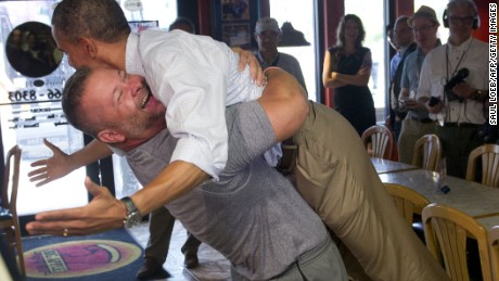 Restaurant owner Scott Van Duzer lifts the president during a Florida campaign visit in 2012.