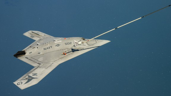 The X-47B receives fuel from an Omega K-707 tanker April 22 while operating over the Chesapeake Bay. This test marked the first time an unmanned aircraft refueled in flight.