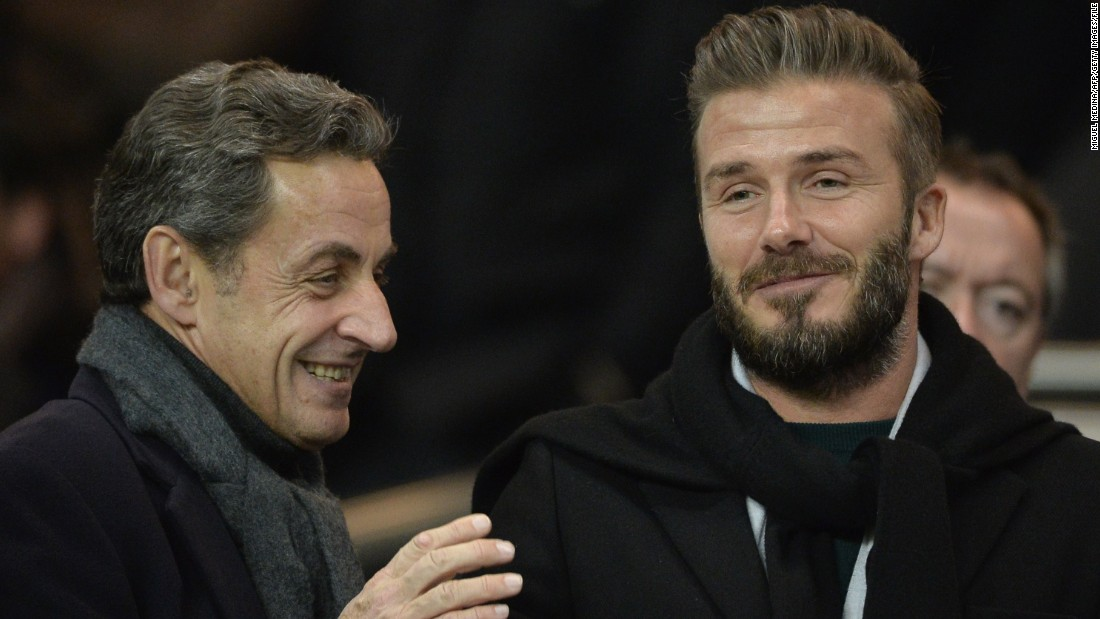 Beckham is now firmly established among the world's most powerful figures -- here he and former French president Nicolas Sarkozy watch PSG play in a Champions League match in February 2015.
