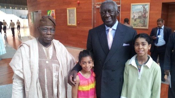 She is pictured here with her younger sister and former Nigerian president Olusegun Obasanjo (left) and ec-Ghanaian president John Kufuor (right).