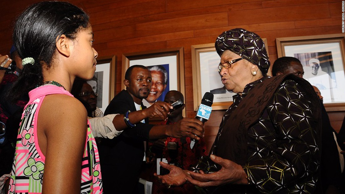 Zuriel Oduwole gets into the media scrum while interviewing Ellen Johnson Sirleaf, president of Liberia.