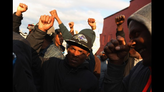 Demonstrators put their fists in the air during a protest outside the Baltimore police